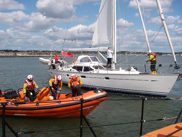 31 May 2011 - The ILB and Mersey class ALB alongside the grounded yacht, with an ILB crew member aboard to secure the tow ropes
