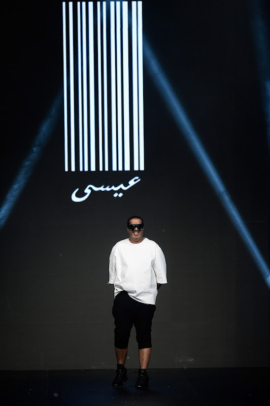 DUBAI, UNITED ARAB EMIRATES - APRIL 12: Designer Essa Bhagoorwala poses at the end of the runway during the Essa show finale during Fashion Forward at Madinat Jumeirah on April 12, 2014 in Dubai, United Arab Emirates.  (Photo by Ian Gavan/Getty Images for Fashion Forward) *** Local Caption *** Essa Bhagoorwala