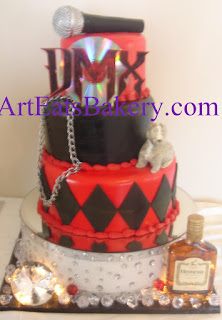 Rapper DMX custom birthday cake design for his party in Spartanburg, SC with black and red fondant, edible microphone, CD, dog chain, pitbull, diamonds, hennesy and lignts