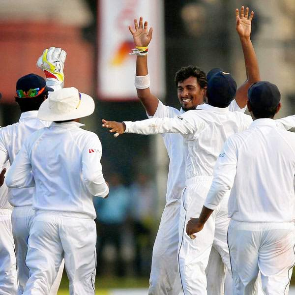 Sri Lanka's Suranga Lakmal (C) celebrates with teammates after taking the wicket of South Africa's AB de Villiers (not pictured) during the first day of their first test cricket match in Galle July 16, 2014.