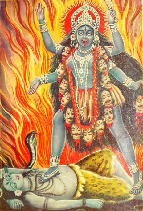 goddess Kali with necklace of skulls standing on the corpse of the god Shiva
