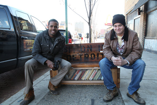 Kyle Bartell and Charles Molnar - the vigilantes behind Sit on it Detroit, enjoying their latest installation - a hybrid bench and public library. From the film Pursuing Happiness