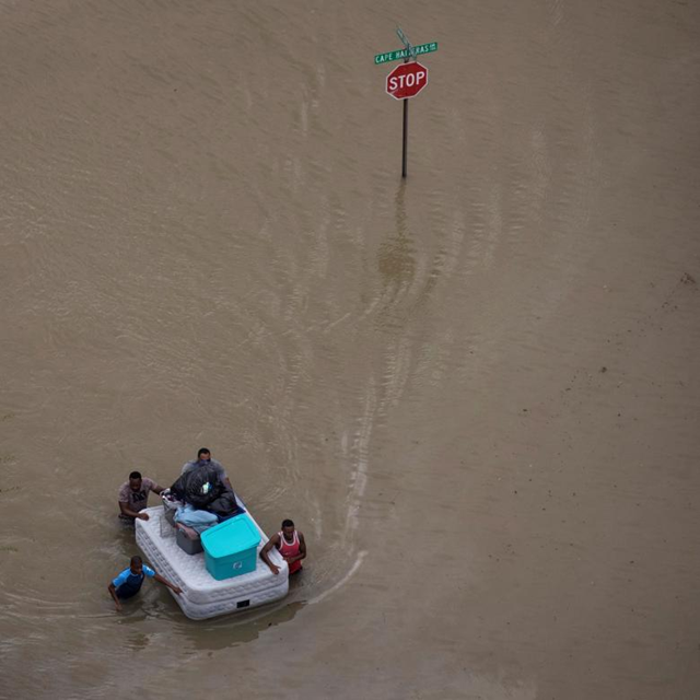 Aerial view of residents wading through Hurricane Harvey floodwaters with their belongings in Northwest Houston. Photo: Adrees Latif / REUTERS