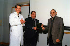 Barron&#039;s father receives a plaque commemorating the inauguration of the Phillip I. Lerner, MD Cleveland Citywide Infectious Diseases Conference, 2002. The stiffness from his Parkinson&#039;s disease is clearly present.<br /> - - - -<br /> Phillip is the subject of his son Barron Lerner&#039;s book The Good Doctor: A Father, a Son, and the Evolution of Medical Ethics (2014, Beacon Press).