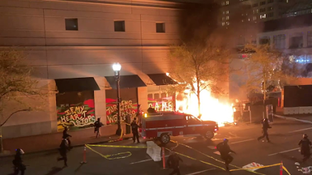 Rioters set fire to Apple Store with two security officers inside