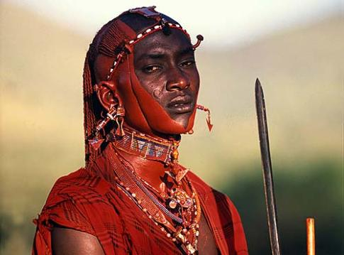 A Red Cloaked Masai Warrior. Such unique cultures can only be experienced on a Kenyan Safari Holiday