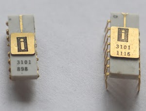 Two 3101 RAM chips. The chip on the right was manufactured slightly later and has a larger lid over the die.
