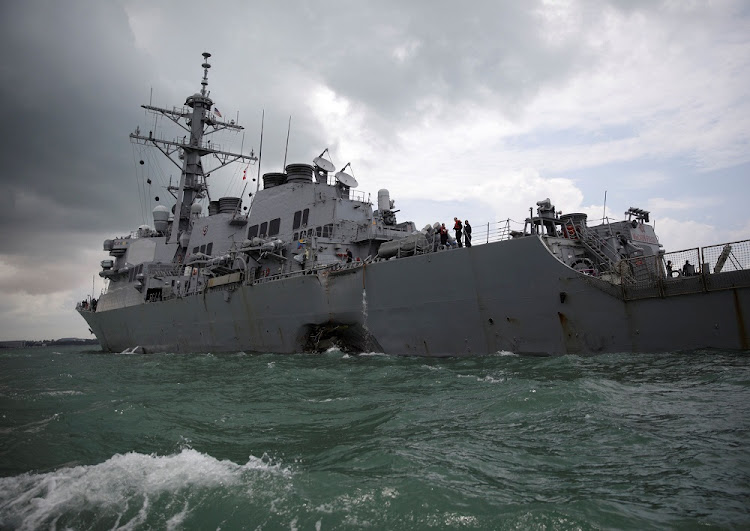 The US Navy guided-missile destroyer USS John S McCain after a collision in Singapore waters on Monday. Picture: REUTERS