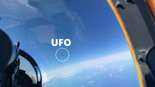 UFO photo taken by the fighter jet pilot in the cockpit.