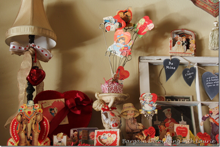 Valentine cards held by cherub