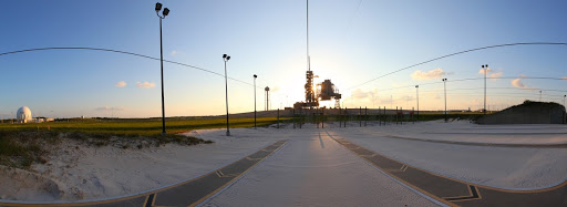 Space shuttle Discovery is attached to Launch Pad 39A as the sun rises over NASA's Kennedy Space Center.