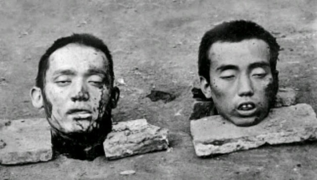 severed heads on ground, south east asia
