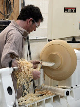 Photo: Stuart shows how to clean up torn grain on a member's bowl blank. Note the delicacy of the grip. No white knuckles here!