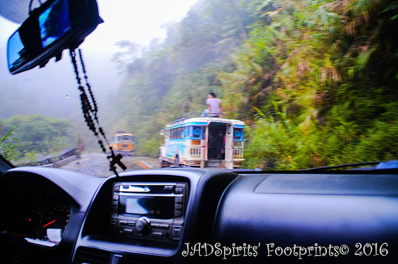 Traversing the zigzag and narrow road to Batad with 2 jeepneys ahead of us