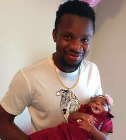 Photos: New Dad, Onazi Ogenyi Dotes Over Daughter