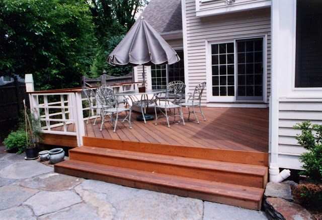 Wide inviting steps lead to dining deck area
