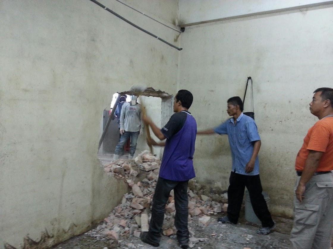 demolsh brick wall