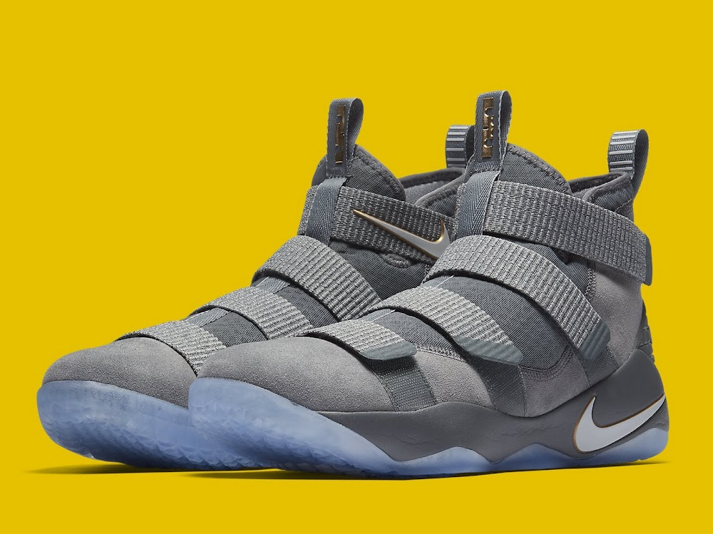 057032a2ba12 ... Available Now LeBron Soldier 11 Cool Grey With a Touch of Gold ...
