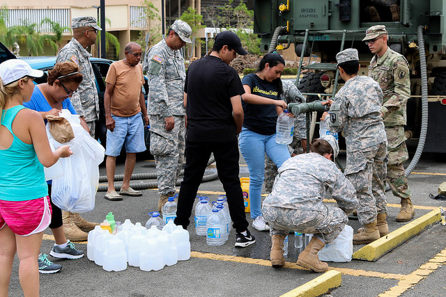 The National Guard delivers water to people in Puerto Rico, after Hurricane Maria. Photo: The National Guard