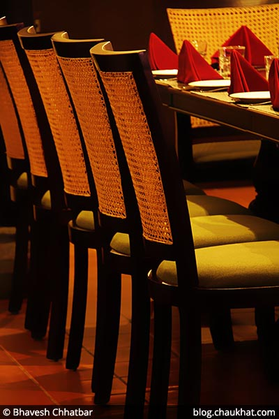 Wooden chairs at Savya Rasa [Koregaon Park, Pune]