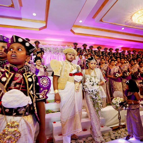 Sri Lankan couple Nalin, center left, and Nisansala, center right, descend from a platform as they attempt to set a Guinness record for a wedding with the most number of bridesmaids for a bride in their wedding ceremony in Negombo, on the outskirts of Colombo, Sri Lanka, Friday, Nov. 8, 2013.