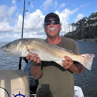 Eddie with a 32 inch Redfish 09-28-2018