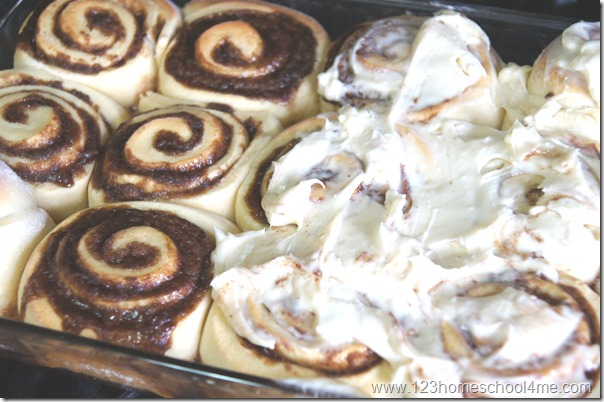 spread frosting over cinnamon rolls