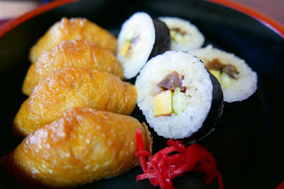 at a restaurant by Fushimi Inari Shrine we felt compelled to get some Inari Sushi which features pieces of aburaage (fried tofu), said to be a favorite food of foxes. Inarizushi is a simple and inexpensive type of sushi, in which sushi rice is filled into aburaage bags
