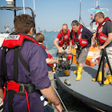 Poole crew members transferring a salvage pump to a 'casualty' vessel in Poole Harbour Photo: RNLI Poole/Dave Riley