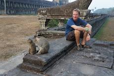 John and monkeys on the wall at Angkor Wat