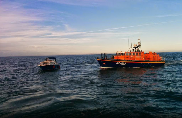 16 July 2014 - Poole ALB about to take over the tow of a 7m day boat with engine failure  Photo: RNLI/Swanage