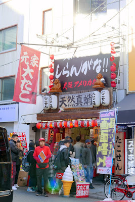 Sights of Osaka - Amerikamura and Takoyaki Stand Shiranngana! (知らんがな!) that I considered is known more for its jokes (for instance, instead of yen it lists prices as ten thousand yen increments but really it's still regular yen- it just means you hear someone say it's 4 million yen but really it's 400). It's specialty is apparently salt flavored takoyaki