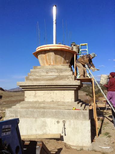 Carrying cement in buckets up to the stupa, October 2013