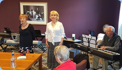 Our host for the day, Margaret Black (in white top) singing with Diane Lyons and Rob Powell accompanying on a Korg SP-250 digital piano.