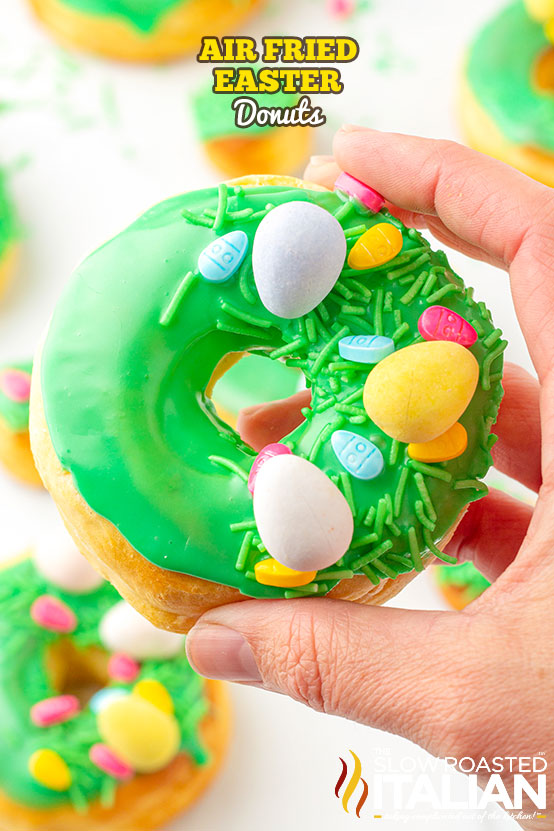 Air Fried Easter Donuts held by a hand