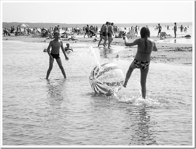 children playing with a ball on parnu beach estonia photo by sue wellington-web