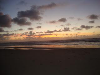 Sunset and sky reflected in a sea Photos - Sao Pedro de Moel
