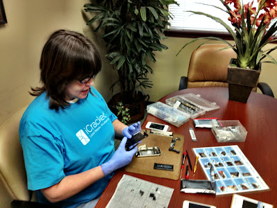 Katherine from iCracked.com repairing iPhones on site at our First American Title branch in Kent, Washington.