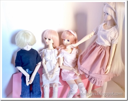 A sitting male ball jointed doll looking sad because the bossy doll with white hair is telling him to go away.  Two other dolls sitting next to him are looking at him with pity.  He has to leave because we are talking about a sensitive subject, doll underwear.