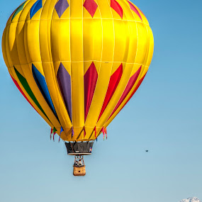 Floating Above the Rockies by Kimberly Sheppard - Transportation Other ( flight, hot air balloon, mountains, yellow, balloon )