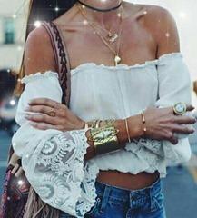 camicia donna e bracciale bigiotteria