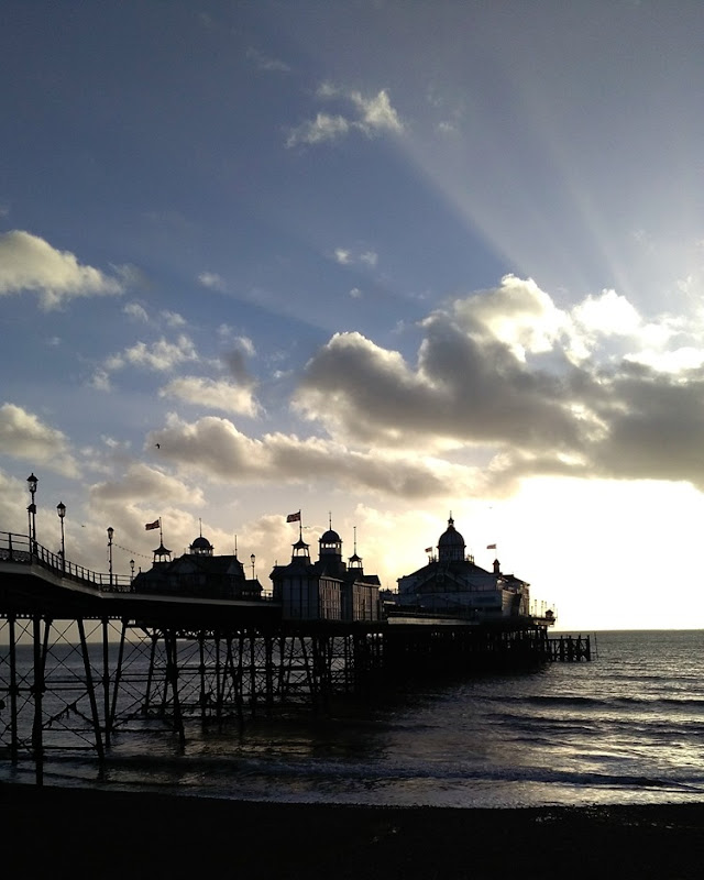 sunbeams over the pier