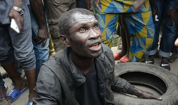 Suspected Kidnapper Nearly Lynched To Death By Angry Mob In Lagos (Photos)