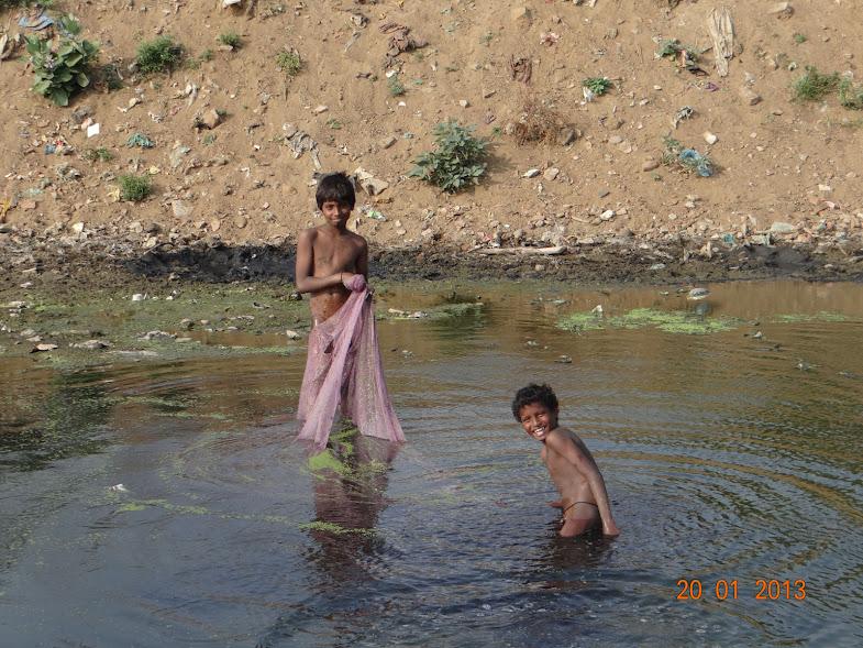 Children taking bath in Adyar River, VGP Salai, Saidapet