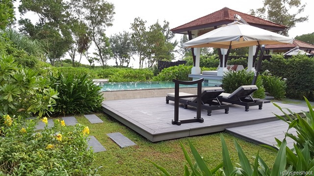 Banyan Tree Lang Co. Private pool, lounge chairs, parasols, outdoor showers and jacuzzi at the doorstep of the luxury villa.