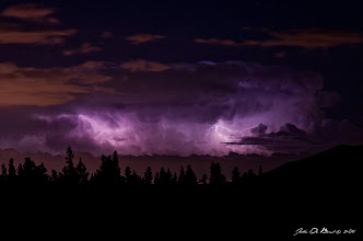 Photo: After a full day of shooting at Brainard Lake of Moose and landscapes with +Kat Dennis and +Shiloh Pfeiffer we were treated to a very amazing thunderstorm that had moved out from the Colorado Rockies and on to the plains and metro Denver. Exiting Brainard Lake we found a spot that overlooked the distant city of Longmont and got to work shooting. It was happening so fast with the lightning that I honestly couldn't even keep up. It seemed each and every second so many lightning strikes went on. This was a hard shoot though as it was VERY dark and I had to let my eyes adjust to it in order to try and set up the composition...otherwise I would be shooting in the dark, literally. In the end I chose to try and frame the forest some and the lightning glowing the clouds above it.  Hope you all like it  John