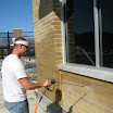 Application of A-Tech Masonry and Brick Sealer to all masonry surfaces, including concrete window sills.