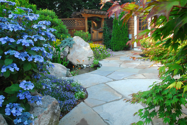 Colorful Planting provides backdrop to natural stone patio