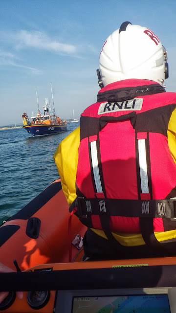 Poole ILB coming up to Poole ALB to take a tow rope across to a yacht aground on Hook Sands - 8 August 2013. Photo: RNLI/Poole
