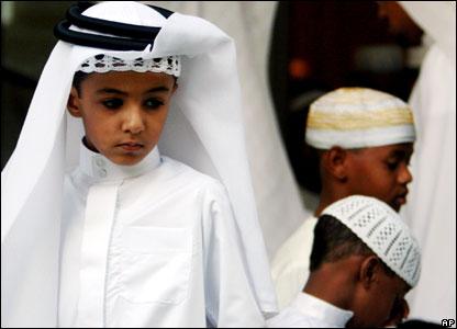 Bahrain - Boys attend Eid al-Fitr dawn prayers at a mosque in Riffa   (photo-news.bbc.co.uk)